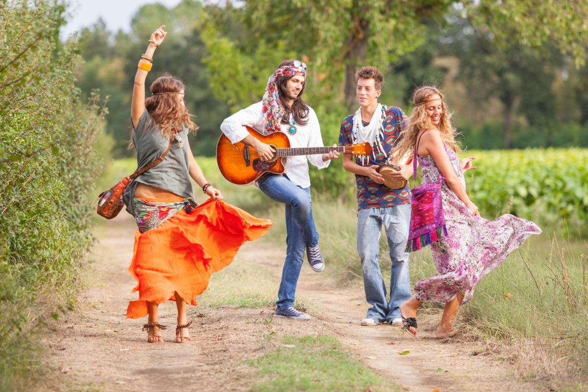 Hippie,Group,Playing,Music,And,Dancing,Outside